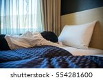 woman lying on the bed | Shutterstock . vector #554281600
