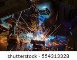 worker is welding the steel... | Shutterstock . vector #554313328