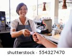 cashier accepts card payment... | Shutterstock . vector #554327470