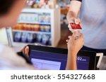 cashier accepts card payment...   Shutterstock . vector #554327668