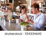 couple enjoying lunch date in... | Shutterstock . vector #554334640