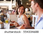 couple enjoying lunch date in... | Shutterstock . vector #554334688