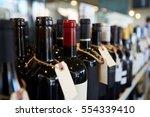 bottles of wine on display in...   Shutterstock . vector #554339410