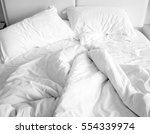 messy bed with morning light.... | Shutterstock . vector #554339974