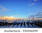 gondolas in venice   sunset...   Shutterstock . vector #554346394