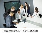 business team on meeting in... | Shutterstock . vector #554355538