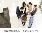 group of business people who... | Shutterstock . vector #554357374