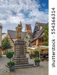 Small photo of Stone statue of Jeanne d'Arc with standard and shield with her coat of arms, Eguisheim, Alsace, France