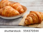 fresh croissants on rustic...