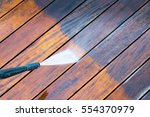 cleaning terrace with a power... | Shutterstock . vector #554370979