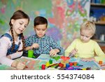 group of cute kids painting...   Shutterstock . vector #554374084