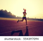young fitness woman runner... | Shutterstock . vector #554397094