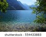 Waterside with crystal clear water at Koenigssee (Königssee), Bavaria near Schönau on a sunny summer day - stock photo