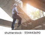 engineer and architect working... | Shutterstock . vector #554443690