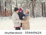 family walk in the winter woods ... | Shutterstock . vector #554449624