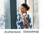 smiling beautiful black woman... | Shutterstock . vector #554449948