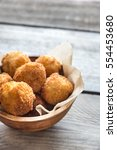 bowl of arancini   rice balls... | Shutterstock . vector #554453680