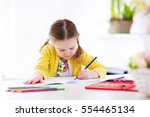 cute little girl doing homework ... | Shutterstock . vector #554465134