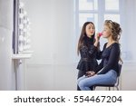 makeup artist applying liquid... | Shutterstock . vector #554467204