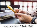 hand woman typing text message... | Shutterstock . vector #554469106