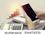 woman using smartphone with... | Shutterstock . vector #554473570