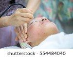 beauty treatment of face skin... | Shutterstock . vector #554484040