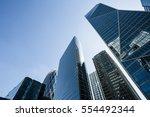 skyscrapers with glass facade.... | Shutterstock . vector #554492344