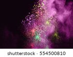 splash of colored powder on... | Shutterstock . vector #554500810