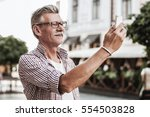 be stylish in any age. smiling... | Shutterstock . vector #554503828