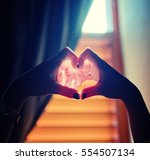 heart in hands | Shutterstock . vector #554507134