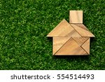 tangram puzzle in home shape on ... | Shutterstock . vector #554514493