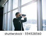 businessman with binoculars... | Shutterstock . vector #554528560