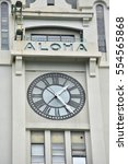 Small photo of Honolulu Hawaii, USA - November 25, 2016: View of the clock face of the landmark Aloha Tower lighthouse at Honolulu Harbor. The Art Deco structure designed by Arthur L Reynolds was built in 1926.