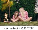mom and daughter walk in the... | Shutterstock . vector #554567008