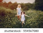 mom and daughter in beautiful... | Shutterstock . vector #554567080