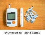 set of glucose meter with... | Shutterstock . vector #554568868