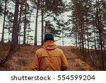man walking in pine tree forest ...   Shutterstock . vector #554599204