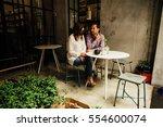couple in love. romantic date... | Shutterstock . vector #554600074