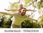 family  parenthood  fatherhood... | Shutterstock . vector #554623324