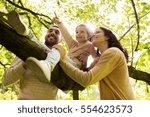 family  parenthood  adoption... | Shutterstock . vector #554623573