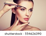 beautiful brunette woman paints ... | Shutterstock . vector #554626390