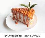 thai tea crape cake on white... | Shutterstock . vector #554629438