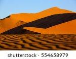 dunes in namib desert   namibia | Shutterstock . vector #554658979
