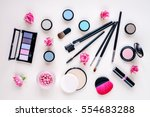 makeup items on a pastel... | Shutterstock . vector #554683288