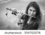 Musician Playing A Wooden Flut...