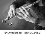 musician playing a wooden flute ... | Shutterstock . vector #554703469