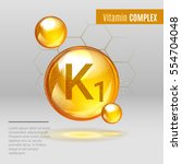 vitamin k1 gold shining pill... | Shutterstock .eps vector #554704048