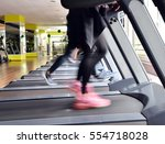 treadmills at the gym center | Shutterstock . vector #554718028
