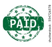 rubber stamp with the word paid ... | Shutterstock .eps vector #554726578