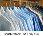 clean hung shirts in the... | Shutterstock . vector #554732413